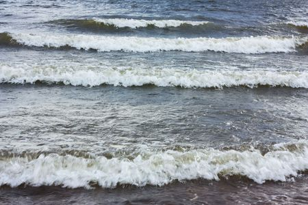 Waves lapping on sandy beach Stock Photo