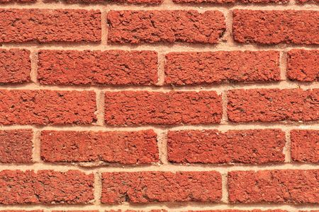 Close-up of a red brick wall on the side of a building Stock Photo