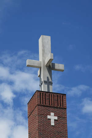 Crucifix at top of church tower Stock Photo