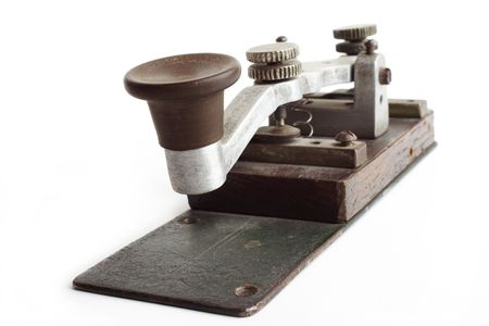 telegraphic communication: Old morse key on white background Stock Photo