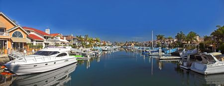 Private harbor, boats and luxury houses photo