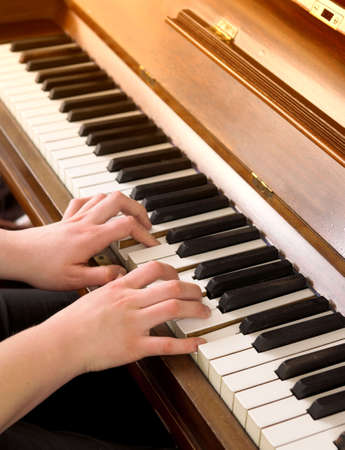 Playing the piano - young woman Stock Photo - 789214