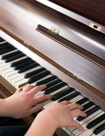 Playing the piano - young woman Stock Photo - 903477