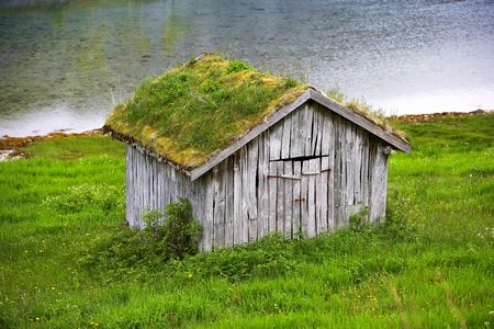 A photo of an old farm cottage north of the Polar Circle in Norway photo