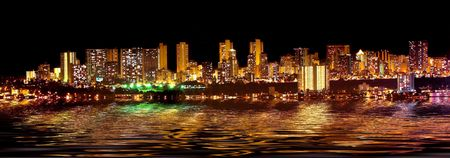 bask: A panorama photo of Honolulu skyline at night