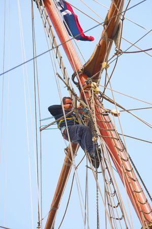 A telephoto of sailors at an old, tall sailing boat Stock Photo - 1311077