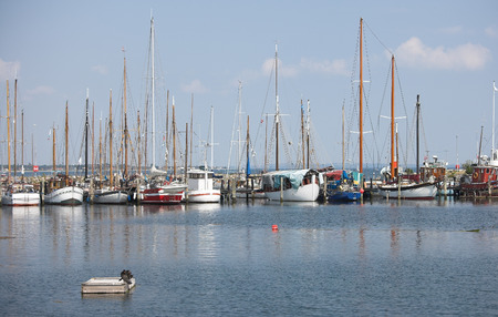 A photo of small fishting boats in the harbor photo