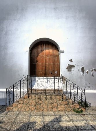 A photo of a round door in an old Spanish house photo
