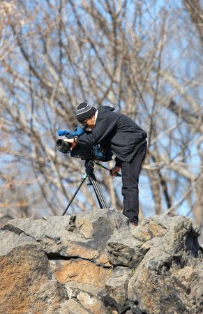 central park: Editorial: TV-News film maker in Central Park, New York Stock Photo
