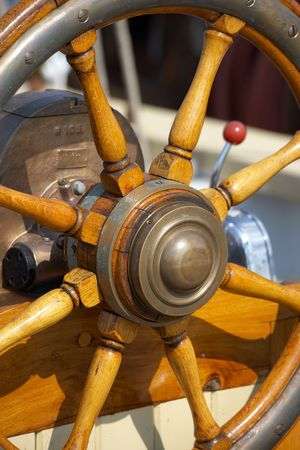 A photo of steering wheel on an old sailing boat photo