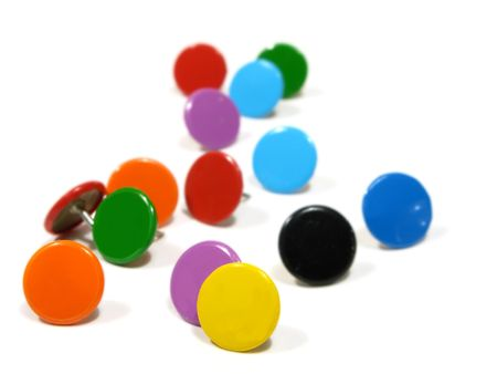 A group of Colorful pins on white background photo