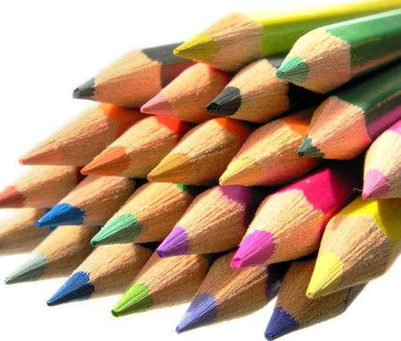 Colorful drawing pencils on a white background photo