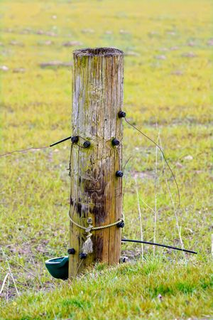 A photo of an old  fence post in the countryside photo