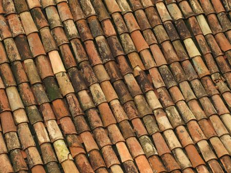 Old red roof tiles from spain photo