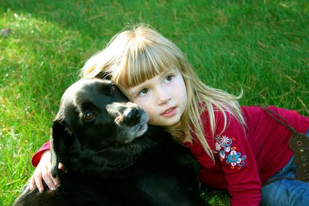 Little girl outdoors hugging her dog. Stock Photo - 568057