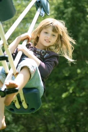 totter: Little Girl in action on teeter totter Stock Photo