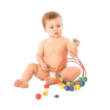 A toddler playing with a multicolored toy photo