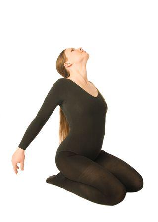 exercices: A young woman doing yoga exercices