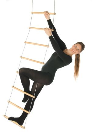 Woman on a rope ladder photo
