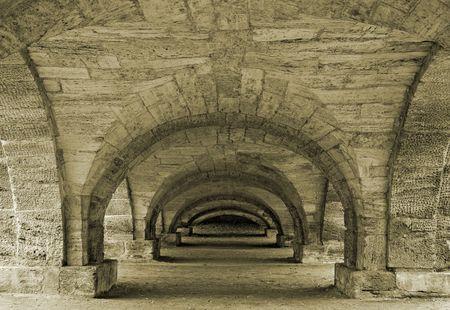 Passage under a decorative bridge in a town of Pushkin, near Saint-Petersburg