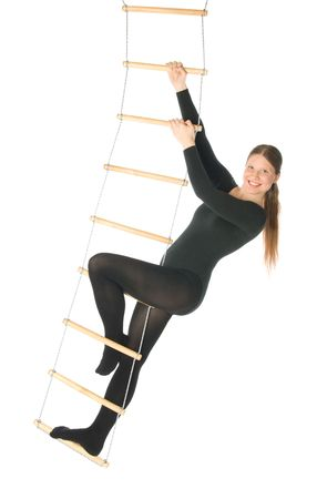 Isolated photo of a woman on a rope ladder photo