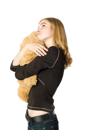Young girl hugging a Teddy bear, isolated photo