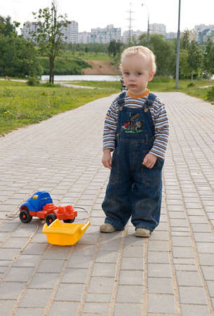 Sad boy with a broken toy truck