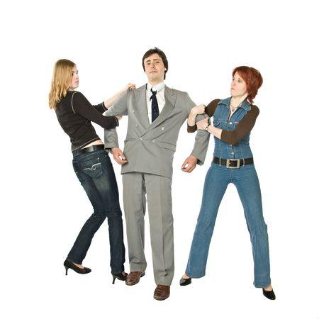 Dos mujeres tirando de un hombre en lados opuestos  Foto de archivo - 3528836