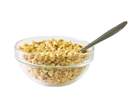popped: A glass bowl full of popped rice Stock Photo
