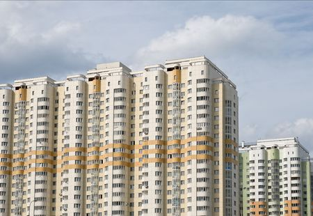 Two multistory residential houses against cloudy sky Stock Photo - 3759086
