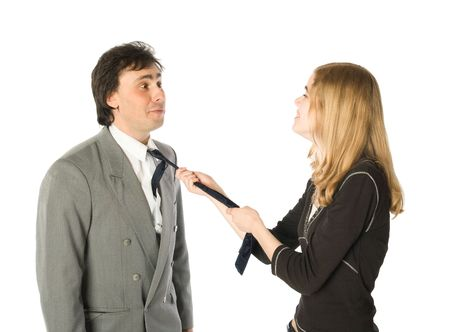 Young pretty woman pulling a man by a necktie photo