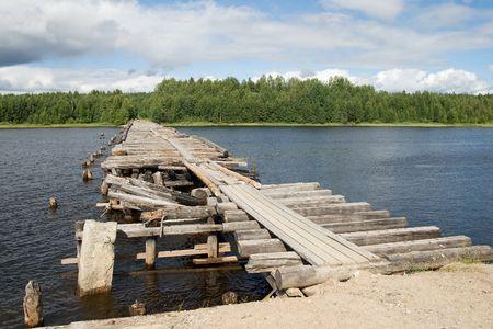 An old broken bridge on a river in Karelia, Russia  Stock Photo