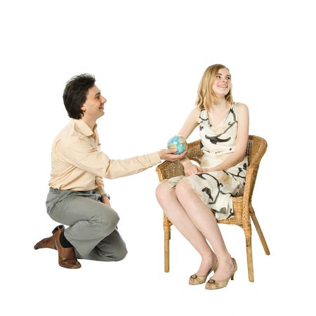 A girl and a man giving her a globe Stock Photo - 4791744
