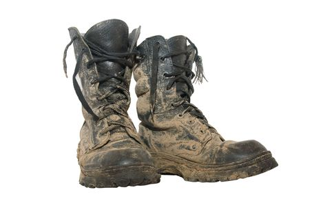 A pair of dirty hiking boots isolated over white Stock Photo - 5291153