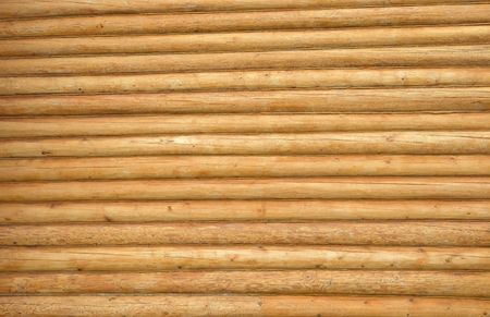 Wooden wall of a loghouse for background