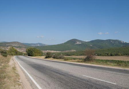 Asphalt road among cliffs in Crimea, Ukraine photo
