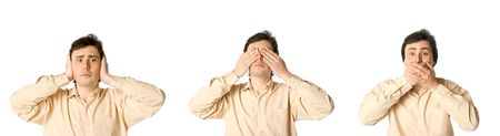 eyes closing: Man closing his ears, eyes and mouth in turn  Stock Photo