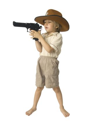 barefoot cowboy: Boy with a toy gun in a hat over white background Stock Photo