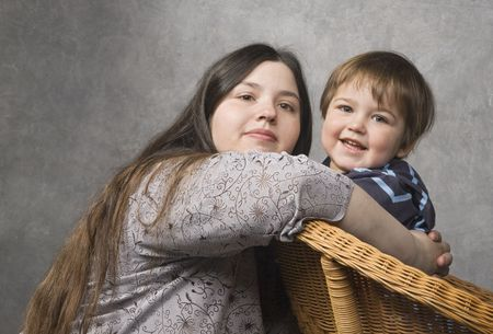 Mother and her son look at camera smiling photo