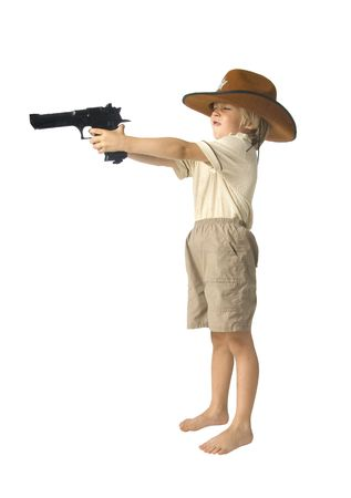 45 gun: Boy with a toy gun in a hat over white background Stock Photo