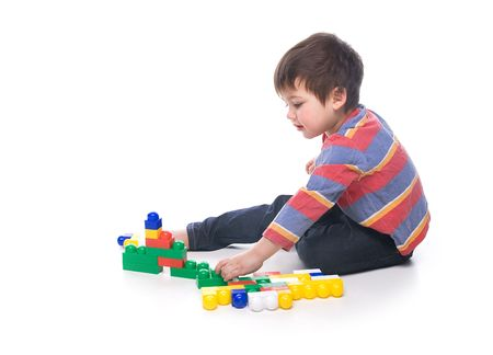 A toddler playing with a multicolored bricks Stock Photo - 6965070