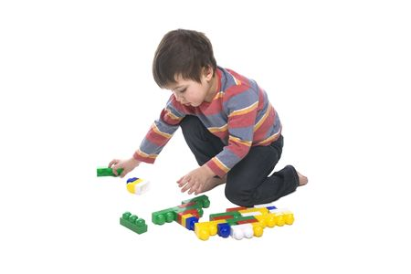 A toddler playing with a multicolored bricks photo