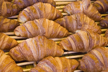 Fresh croissants on a tray in a market Stock Photo - 11029556
