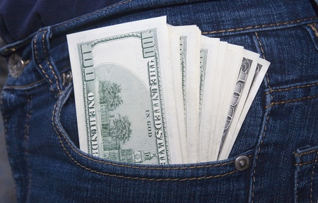 Bundle of dollars in a jeans rear pocket Stock Photo