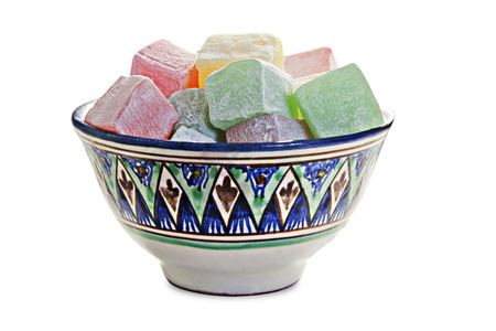 Bowl with turkish delight, isolated over white photo