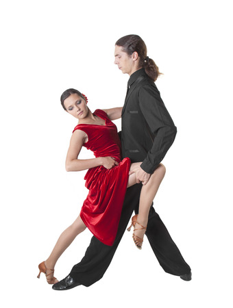 Young couple dancing tango isolated over white photo