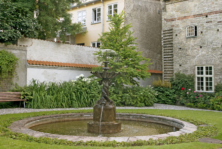 northern european: Courtyard with a fountain in a northern european town