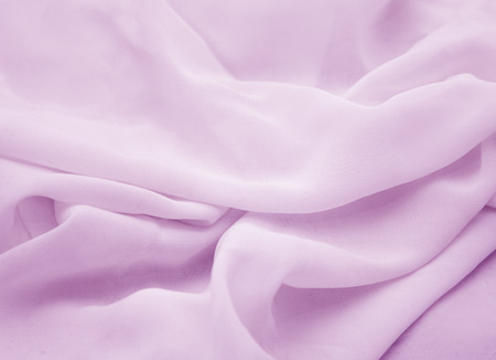 Pleats of pink chiffon close-up for background