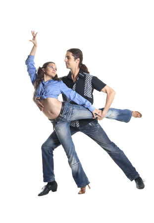 Dancing couple isolated over white background photo