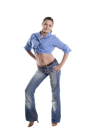 chemise: Young woman in jeans and short chemise isolated over white